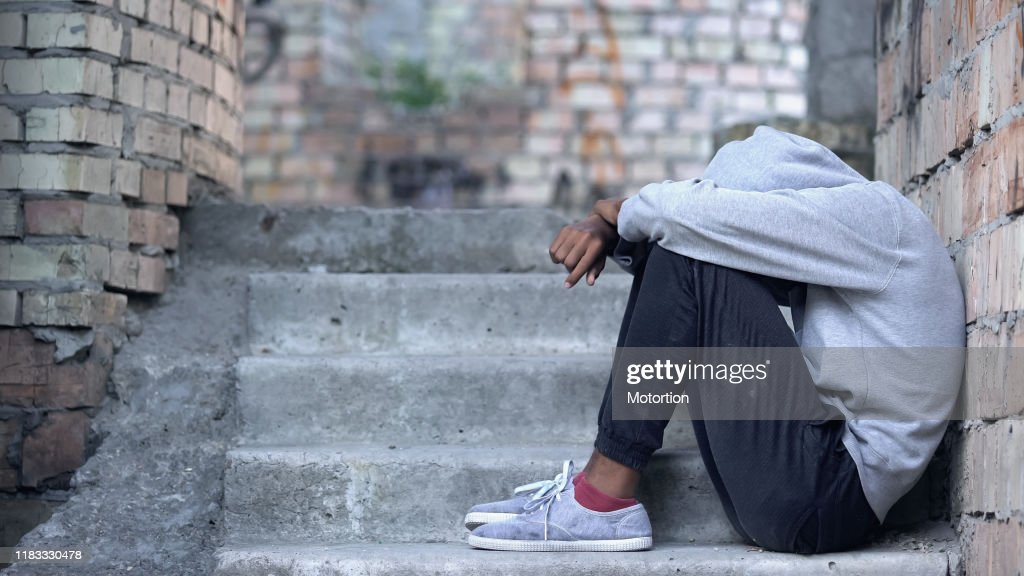 Lonely male teen sitting building stairs, misunderstanding depression, problem : Stock Photo