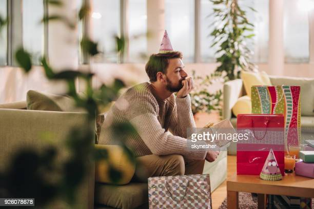 lonely man celebrating birthday alone at home. - negative emotion stock pictures, royalty-free photos & images