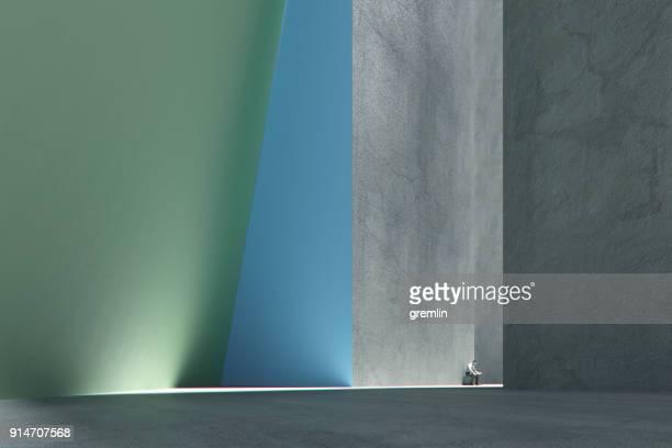 Einsamer Mann im futuristischen konkrete städtische Umwelt