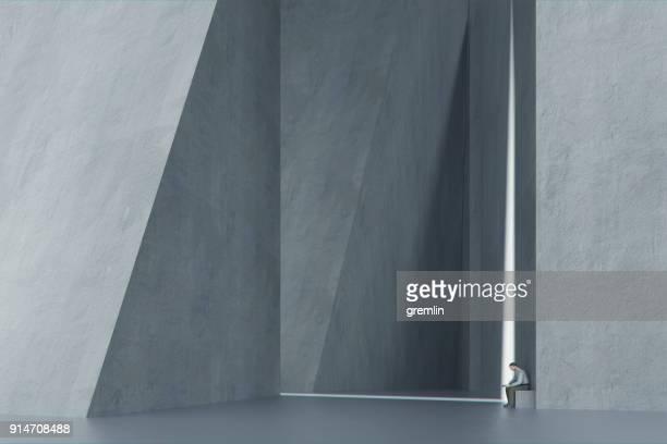 Lonely man in futuristic concrete urban environment