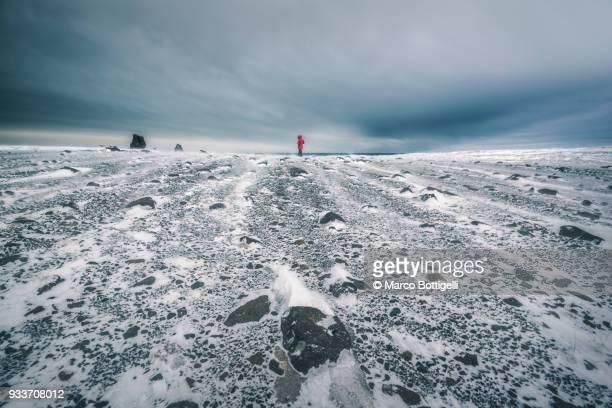 lonely man in stormy weather, iceland. - abbandonato foto e immagini stock