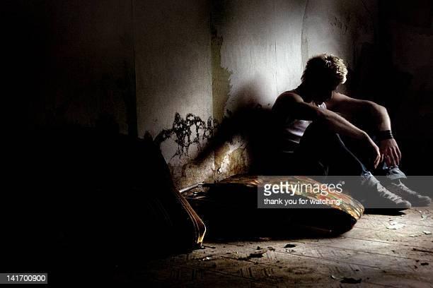 Lonely man sitting in dark room