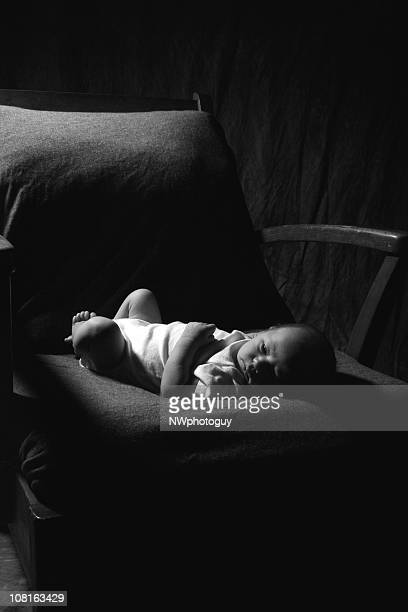 Lonely Newborn Baby Lying in Old Chair