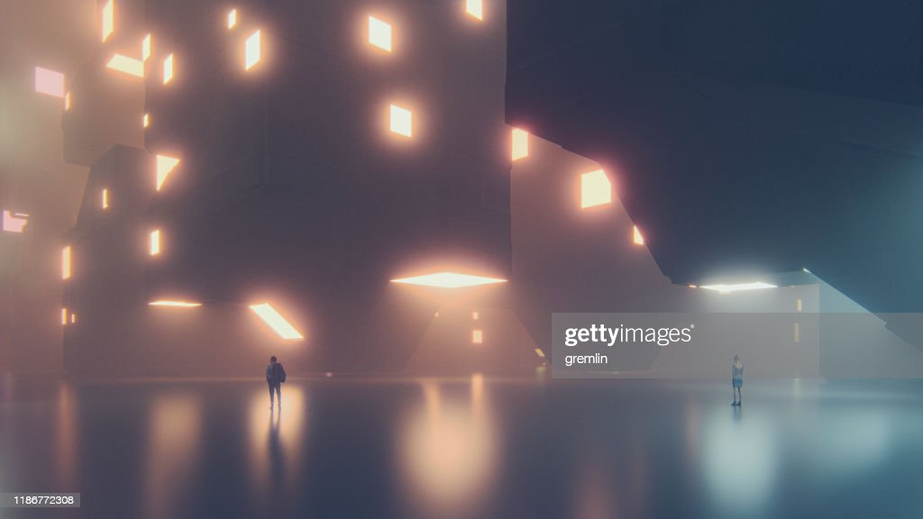 Lonely people in big, empty futuristic city : Stock Photo