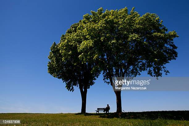 Lonely person sitting on bench