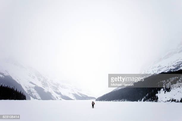 Lonely person skiing in valley