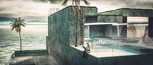Einsam reiche Mann lesen Zeitung in seinem Urlaub Villa