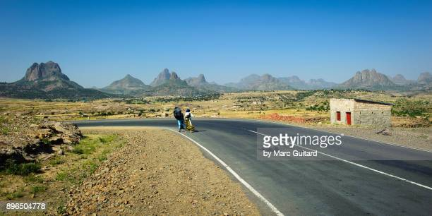 lonely road in the adwa mountains, tigray, ethiopia - tigray stock photos and pictures