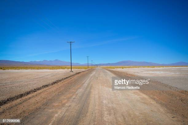 lonely road in the desert, jujuy province, argentina - radicella stock photos and pictures