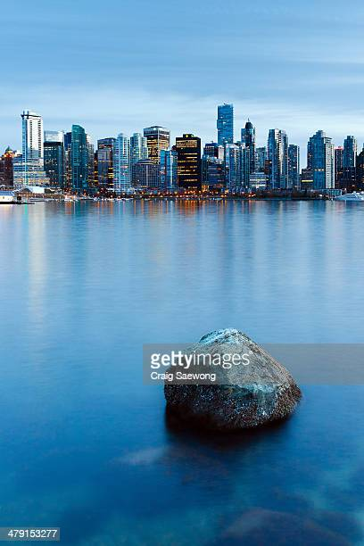 lonely rock - stanley park stock photos and pictures