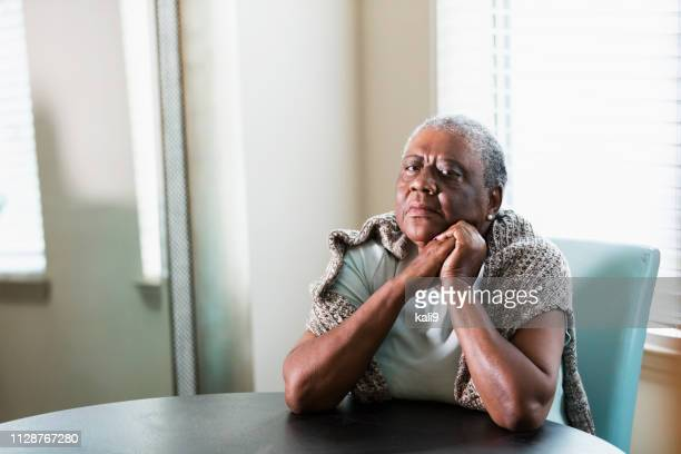 lonely senior african-american woman at home - african american ethnicity imagens e fotografias de stock