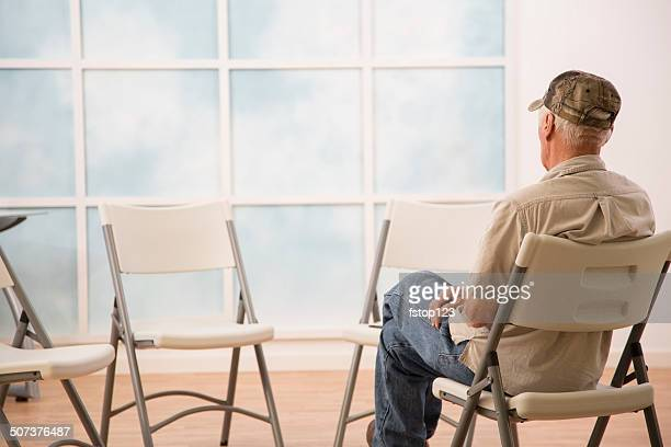 Lonely senior man waits for support, counseling group to arrive.