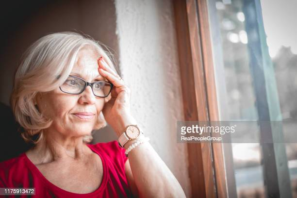 lonely senior woman - dementia stock pictures, royalty-free photos & images