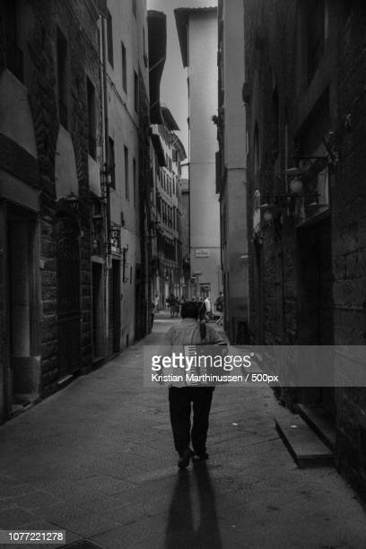 A lonely street musician in Florence