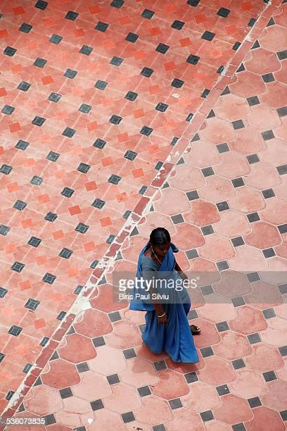 Lonely tamil woman walking in Thanjavur town Tamil Nadu India