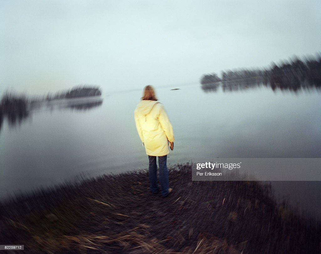 A lonely woman by a lake Sweden. : Stock Photo