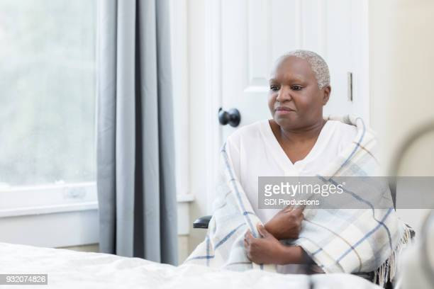 lonely woman in a nursing home - old woman in sick bed stock photos and pictures
