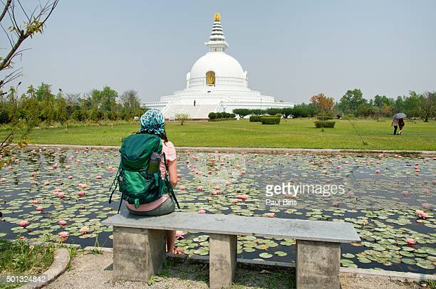 Lonely woman  looking at World Peace Pagoda in Lumbini