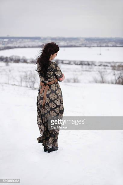 lonely woman standing alone on the hill - long dress stock pictures, royalty-free photos & images