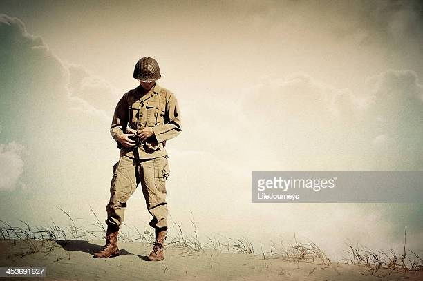 lonely wwii soldier portrait - dreaming of home - army soldier stock photos and pictures