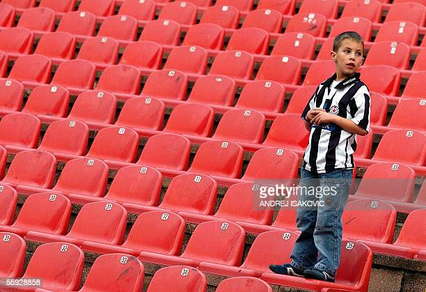 A lonely young supporter of FC Partizan Belgrade stands on the part of Marakana stadium where usually gather the fans of Partizan in Belgrade 15...