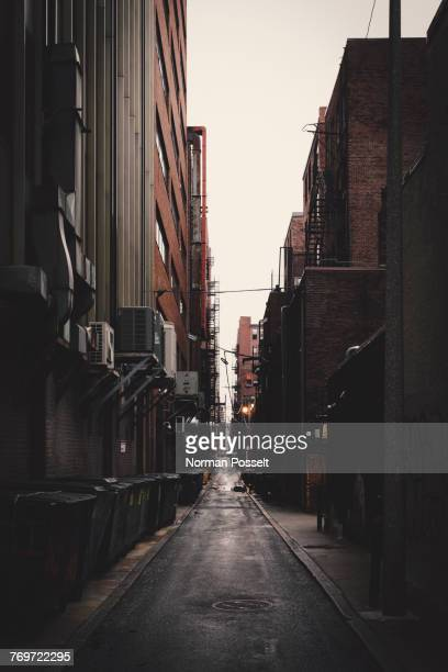 Long alley amidst buildings in city, New York City, New York, USA