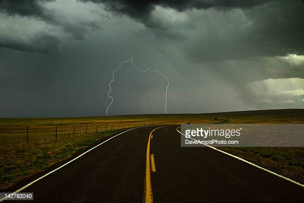 Long and winding road against lighting strike
