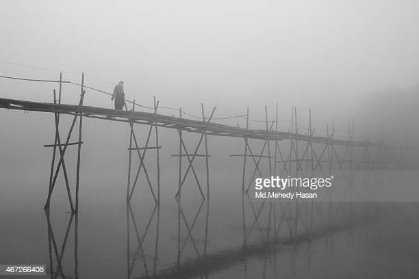 CONTENT] Long bamboo bridge in foggy day