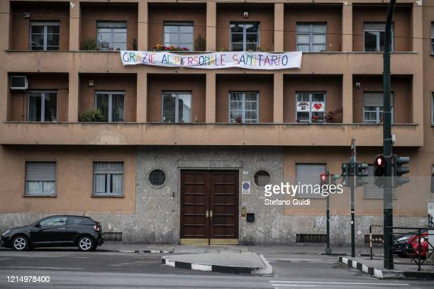 A long banner with the words thanks to the medical staff attached to the balconies near the entrance to the Molinette Hospital on March 26 2020 in...