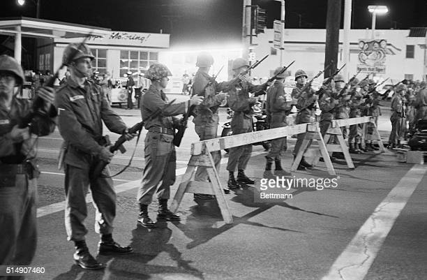 Long Beach, CA- National Guardsmen line a barricade in Long Beach. Governor Brown summoned them to stop further violence, after a policeman was...