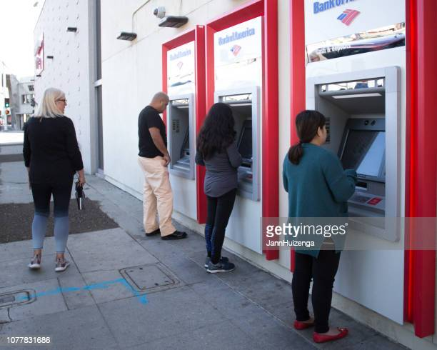 Long Beach, CA: People Using Sidewalk ATM Machines
