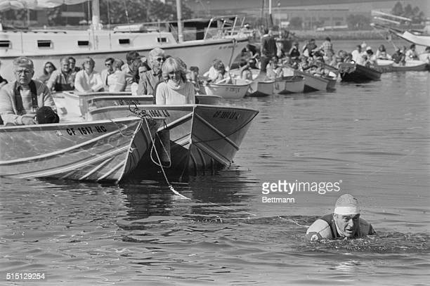 Long Beach, California: Fitness enthusiast Jack LaLanne, celebrating his 70th birthday 11/20, swims through Long Beach Harbor towing a flotilla of 70...
