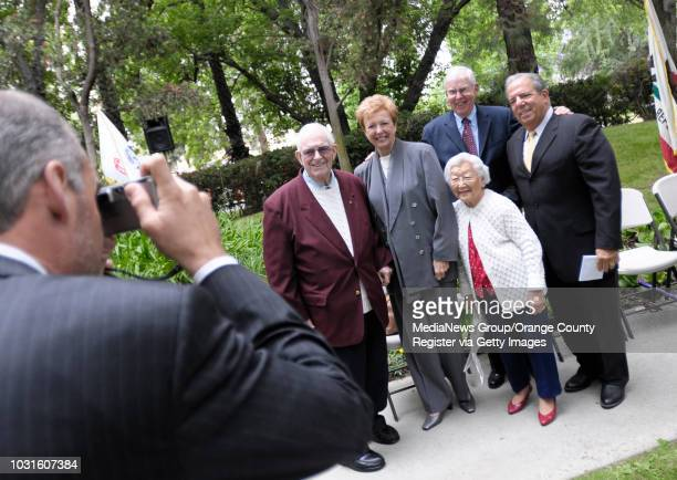 BEACH Long Beach councilman Gary DeLong takes a pictures of Former Rear Admiral John Higginson with mayor Bob Foster right and former mayors Beverly...