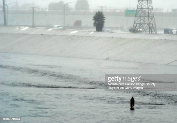Scott Varley Los Angeles Newspaper Group Long Beach fire police and lifeguards responded to a call of a woman walking in waist deep water in the Los...