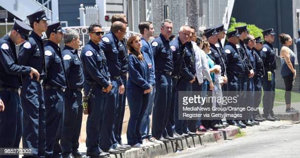 Long Beach firefighters line 11th Street as they wait for the body of Long Beach Long Beach Fire Department Capt Dave Rosa to leave St Mary Medical...