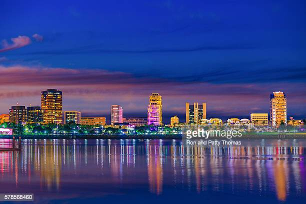 long beach harbor with skyline and water reflections, ca - long beach california stock photos and pictures