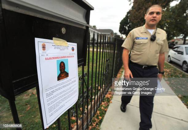 Long Beach homicide detectives along with police explorers and search and rescue personnel canvassed a North Long Beach neighborhood handing out...