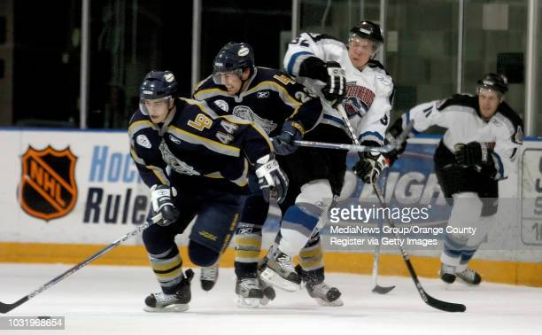 4/13/05 Long Beach Ice Dog's Michael Lambert and Christian Larrivee keep the puck from Idaho's Tim Verbeek during their round one Kelly Cup playoff...
