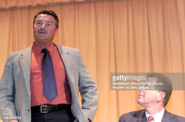 2/09/06 Long Beach mayoral candidate John Stolpe left address the crowd as fellow candidate Frank Colonna listens during a debate at Fremont...