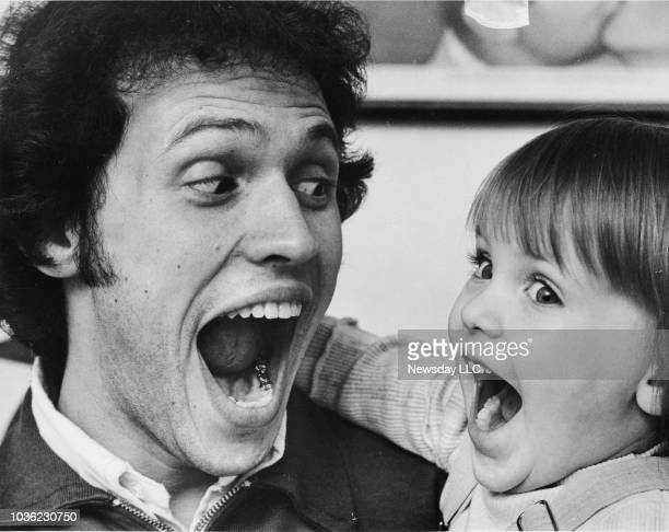 Comedian Billy Crystal and his daughter Jennifer make faces for the camera at Crystal's home in Long Beach New York on January 15 1976