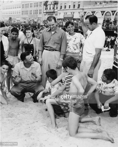 On August 12 youngsters surround New York Yankees players Ralph Houk Charley Silvera and Allie Reynolds at the annual 'Orphans Day' outing at Long...