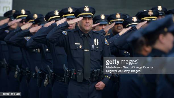Long Beach police officers stand at attention during a memorial ceremony in Long Beach CA on Tuesday May 3 2016 In an annual tradition police and...