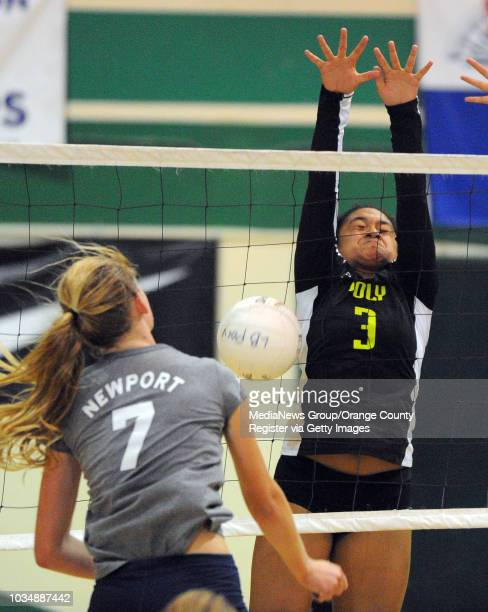 Long Beach Poly girls volleyball defeated Newport Harbor 32 at Poly High in Long Beach CA on Thursday September 5 2013 Poly's Nunu Lutali blocks a...