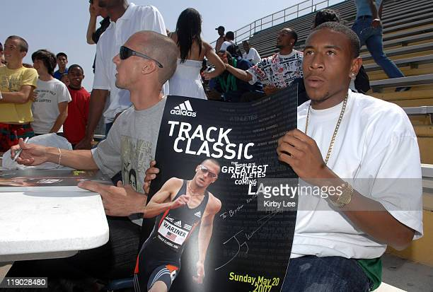 Long Beach Poly High senior Bryshon Nellum poses with poster autographed by 2004 Olympic 400meter gold medallist Jeremy Wariner in Long Beach Calif...