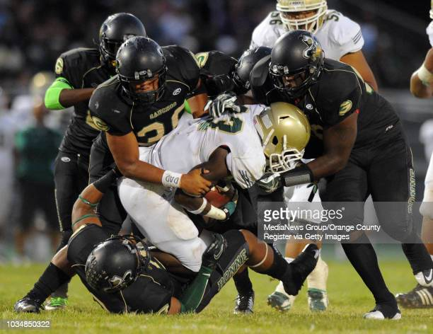 CITY 09/07/12 Long Beach Poly vs Narbonne preseason varsity football at Narbronne High 1st half A group of Narbonne defenders bring down Poly's...