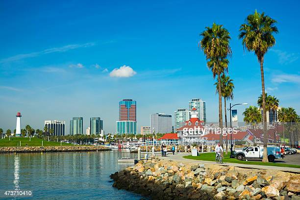 long beach scene with skyline, landmarks, palm trees, and people - long beach california stock photos and pictures