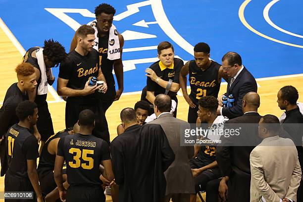 Long Beach State 49ers head coach Dan Monson talks to his team during a timeout in an NCAA basketball game between the Long Beach State 49ers and the...