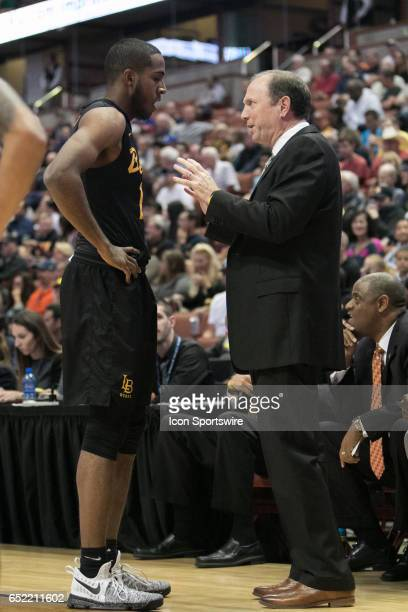 Long Beach State Head Coach Dan Monson chats with Long Beach State Guard Barry Ogalue during a Big West Conference Semifinals Game between UC Irvine...