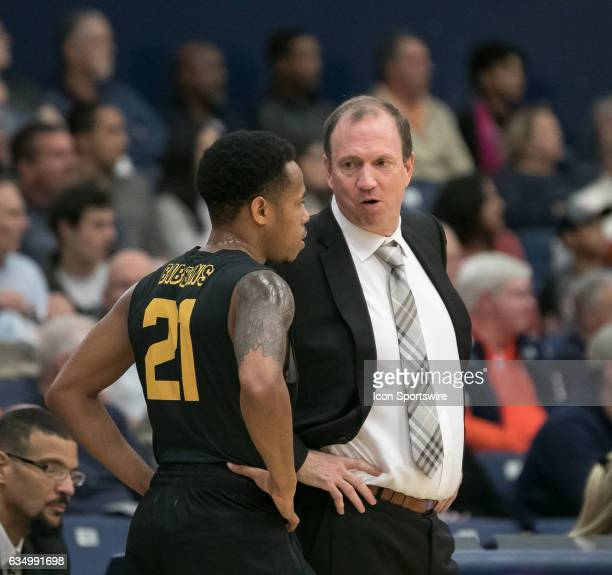 Long Beach State Head Coach Dan Monson instructs Long Beach State Guard Justin Bibbins during a game between Long Beach State and Cal State Fullerton...