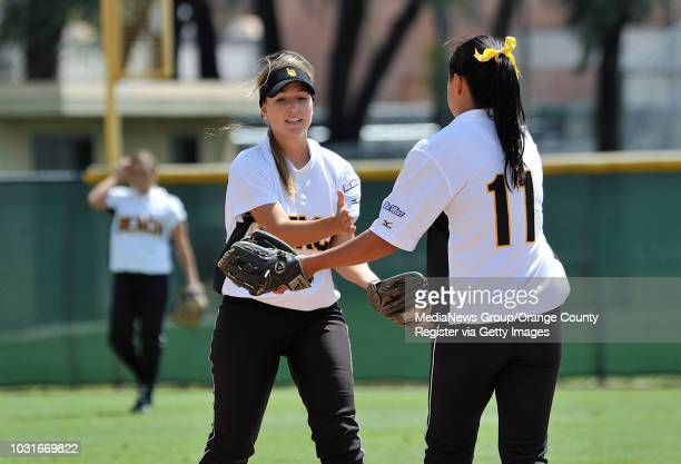 BEACH CA Long Beach State's Ashley Levine celebrates with teammate Nalani St Germain after tagging Pacific's Karie Wilson out at secondbase during...